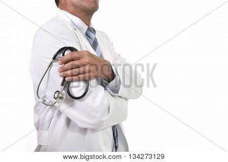 anonymous crop face male medicine doctor holding stethoscope in his hand wearing medical gown standing proud in corporate portrait isolated on white background
