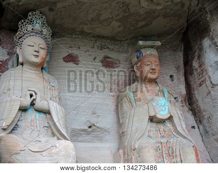 The complex of Buddhist rock sculptures located near monastery Mingshansi in remote rural areas (about 55 km from the county capital Anyue, Sichuan province, China). The heights of the 13 statues carved from rock are 4-6 m. It dates back to the 11-12th ce