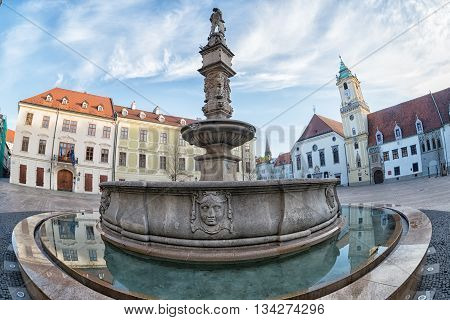 old fountain in the Main Square (Hlavne namestie) in Bratislava in the early morning