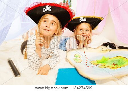 Two little girls in three-corned hats, playing pirates at imagine ship