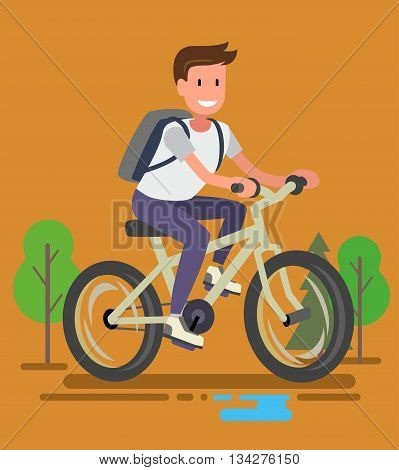 Young bicyclist man with bike on forest road