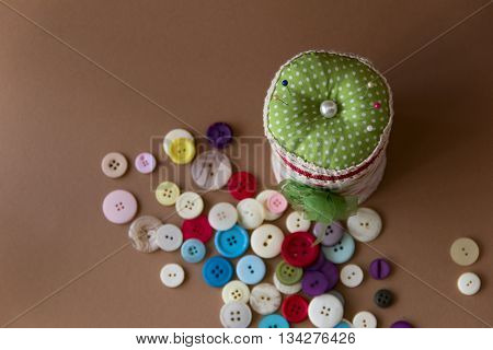 box with many pillow for needles and buttons.view from above. needlework. sewing. the photo