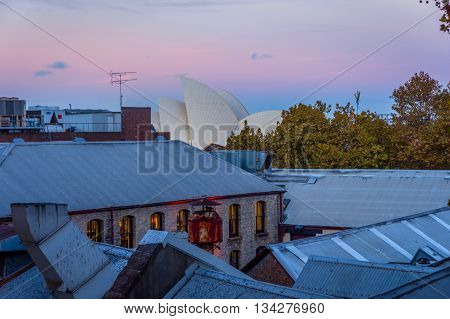 SYDNEY, AUSTALIA - APRIL 21: Rooftops in Sydney city center with Opera house behind. April 2016