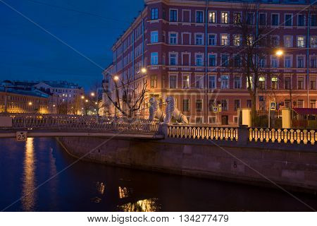 SAINT PETERSBURG, RUSSIA - APRIL 23, 2016: Griboyedov canal and the Lion bridge, night in april. Historical landmark of the city Saint Petersburg