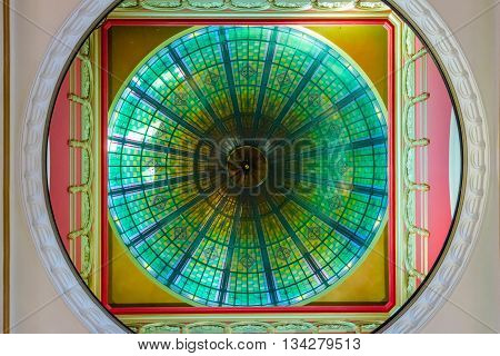 SYDNEY, AUSTRALIA - APRIL 17: Bright ceiling ornament made of stained colorful glass in Sydney Queen Victoria shopping mall from below. April 2016