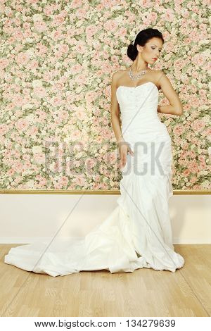 Beautiful woman in white evening gown fashion portrait