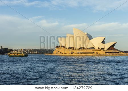 Sydney Opera House And Ferries Passing