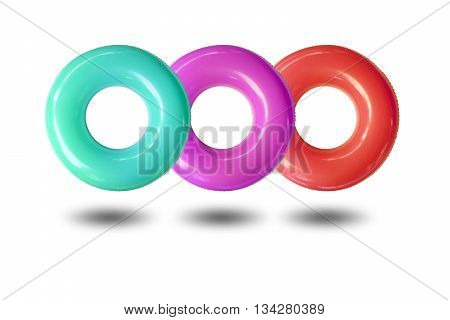 Group of colorful swim rings was derived from the inner tube the inner enclosed inflatable part of older vehicle tires.