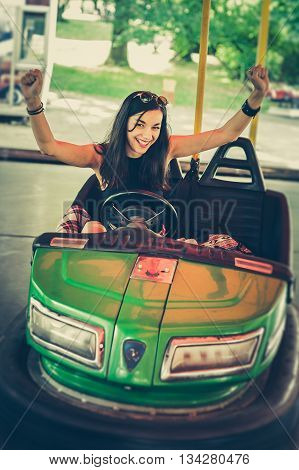 Young Woman Having Fun In Electric Bumper Car