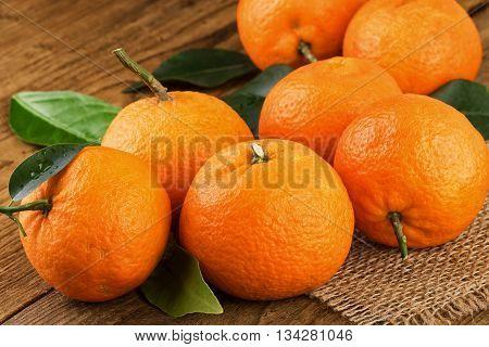 TRipe tangerines  mandarins on a rustic background.