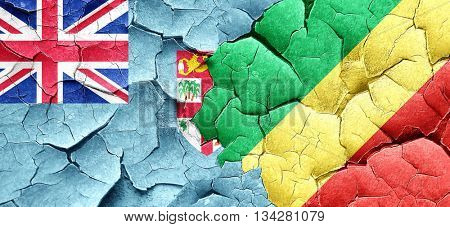 Fiji flag with congo flag on a grunge cracked wall