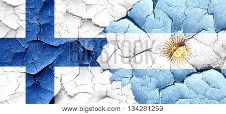 finland flag with Argentine flag on a grunge cracked wall