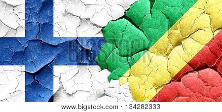 finland flag with congo flag on a grunge cracked wall