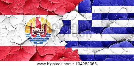 french polynesia flag with Greece flag on a grunge cracked wall