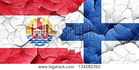 french polynesia flag with Finland flag on a grunge cracked wall