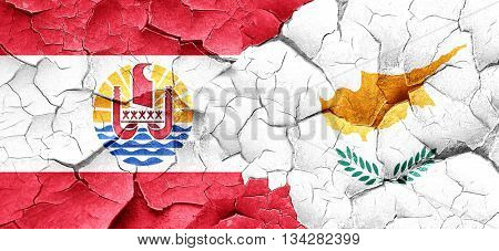 french polynesia flag with Cyprus flag on a grunge cracked wall
