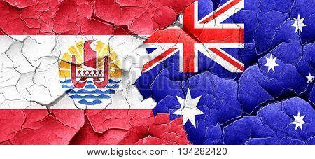 french polynesia flag with Australia flag on a grunge cracked wa