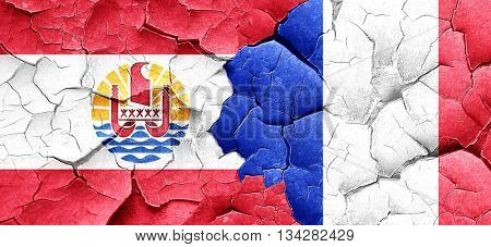 french polynesia flag with France flag on a grunge cracked wall