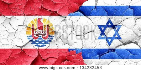 french polynesia flag with Israel flag on a grunge cracked wall