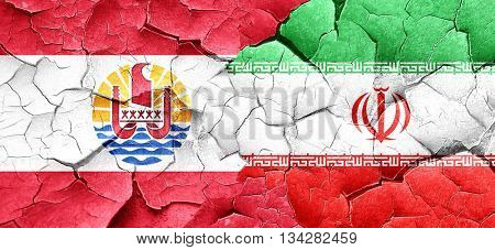 french polynesia flag with Iran flag on a grunge cracked wall