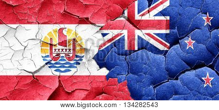 french polynesia flag with New Zealand flag on a grunge cracked