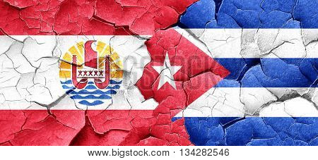 french polynesia flag with cuba flag on a grunge cracked wall