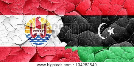 french polynesia flag with Libya flag on a grunge cracked wall