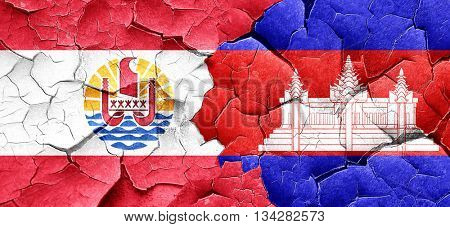 french polynesia flag with Cambodia flag on a grunge cracked wal