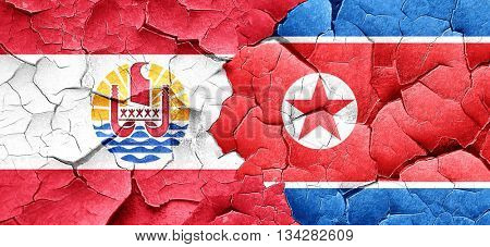 french polynesia flag with North Korea flag on a grunge cracked