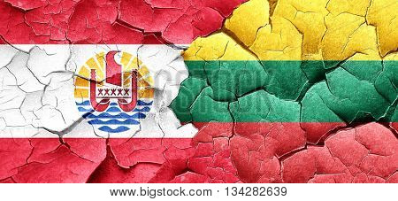 french polynesia flag with Lithuania flag on a grunge cracked wa