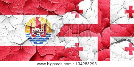 french polynesia flag with Georgia flag on a grunge cracked wall