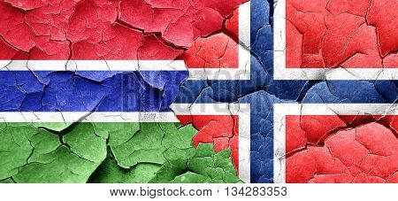 Gambia flag with Norway flag on a grunge cracked wall