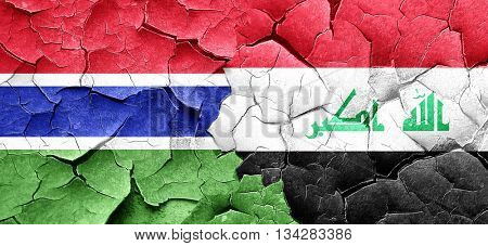Gambia flag with Iraq flag on a grunge cracked wall
