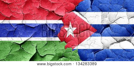 Gambia flag with cuba flag on a grunge cracked wall