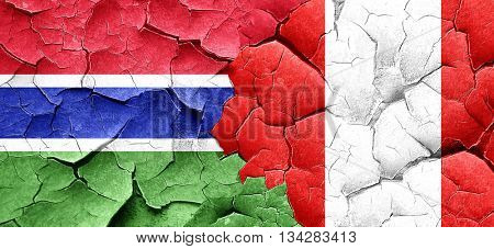 Gambia flag with Peru flag on a grunge cracked wall