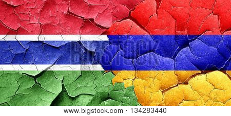Gambia flag with Armenia flag on a grunge cracked wall
