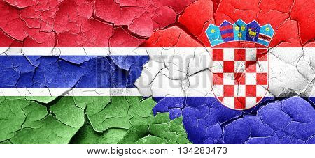 Gambia flag with Croatia flag on a grunge cracked wall