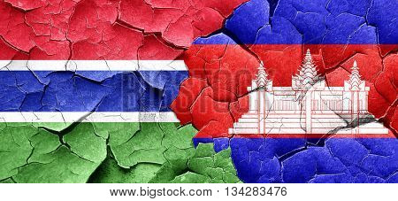 Gambia flag with Cambodia flag on a grunge cracked wall