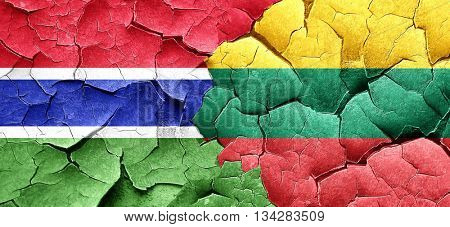 Gambia flag with Lithuania flag on a grunge cracked wall