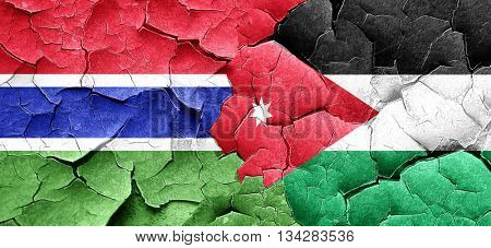 Gambia flag with Jordan flag on a grunge cracked wall