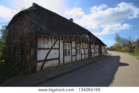 WEITENHAGEN GERMANY - APRIL 20 2016 : Facade of a historic house with reed roof.