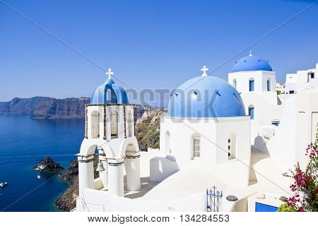 Santorini famous scene with the three domes