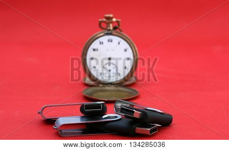 Picture of Time to save your data . USB memory sticks in front of vintage pocket watch