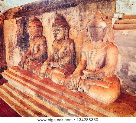 Three Buddha statues at Takhaung Mwetaw pagoda in Sankar. Myanmar.