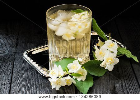 Refreshing cold green tea with jasmine and ice in a glass