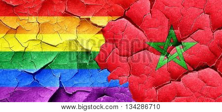 Gay pride flag with Morocco flag on a grunge cracked wall