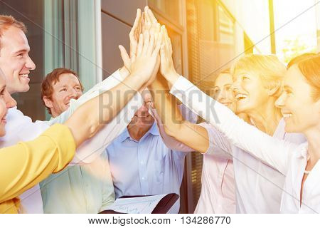 Start-up business team giving High Five with their hands in summer