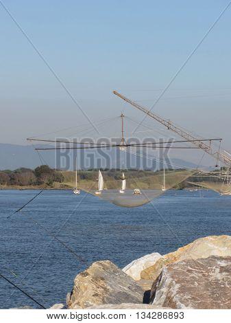Typical italian fishing net along the river Arno in Marina di Pisa Tuscany Italy