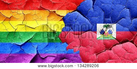 Gay pride flag with Haiti flag on a grunge cracked wall