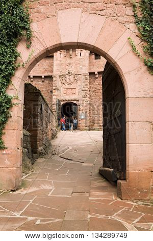 HAUT-KOENIGSBOURG FRANCE - SEPTEMBER 08 2010: The entrance to Haut-Koenigsbourg castle in Alsace France. The castle was known from 1147. It was abandoned during Thirty Years' War and was restored in 1900.